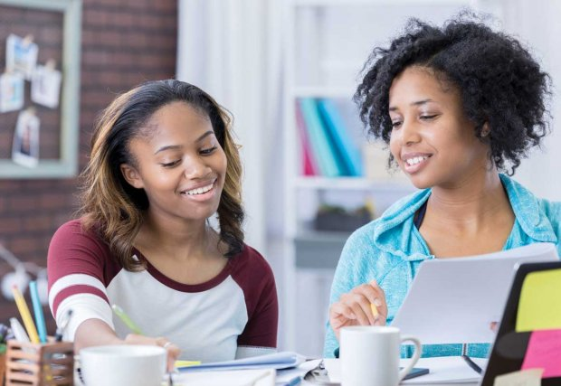 Two young women working on homework